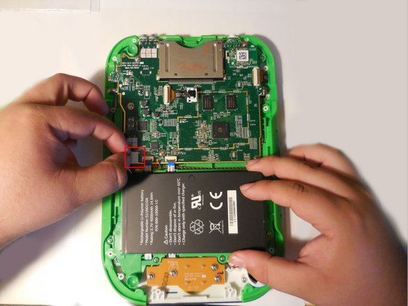 Disconnect the battery using tweezers or your fingernails.