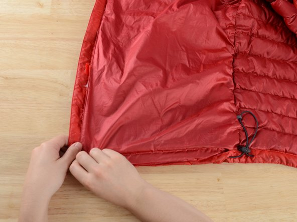 Fold back the lining so it stays clear of the area that needs repair.