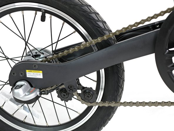 The chain runs outside the rear rocker swing, and has a handy rear chain stretcher, making removal pretty simple.