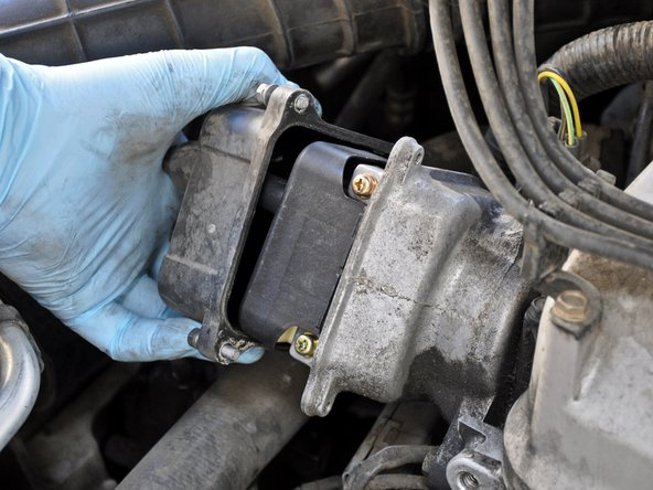 Pull the distributor cap away from the engine and set it aside.