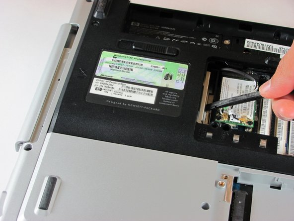 Locate the optical drive. The optical drive is located on the left side of the RAM bay.