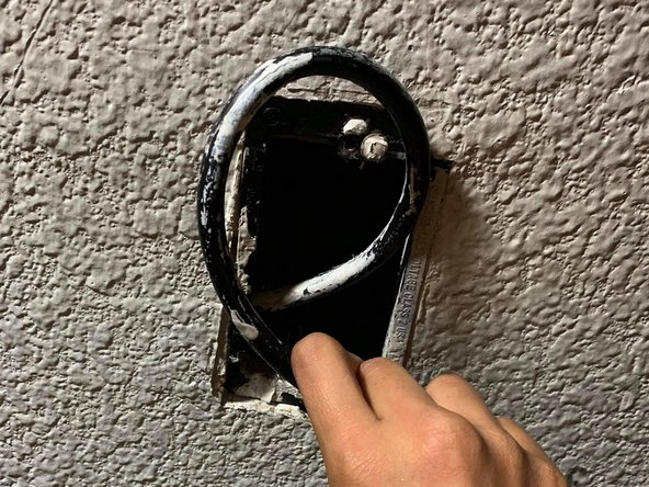 Insert any cable or cables that may be hanging out inside of the wall hole.