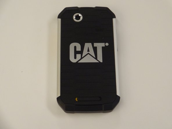 Place the phone screen-side down and place thumb on the yellow and black switch. Slide the switch to the right to unlock the back covering for removal.
