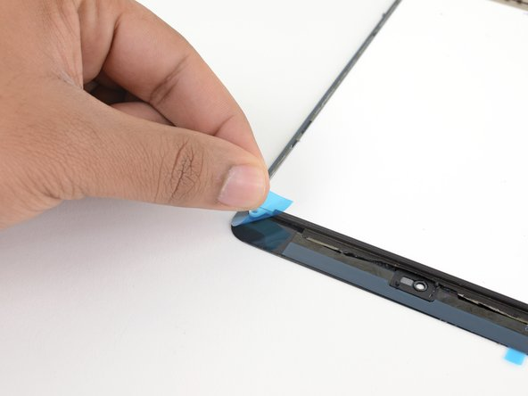 Peel and remove the four colored plastic liners to expose the adhesive.