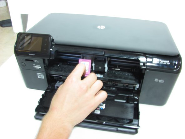 Place the new cartridge into the slot and press firmly until it pops into place.