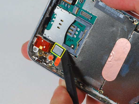 "Use a spudger to disconnect the ribbon cable labeled ""5."""