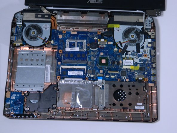 Once you have successfully removed the keyboard plate, locate the two blue rectangles in the middle of the laptop.
