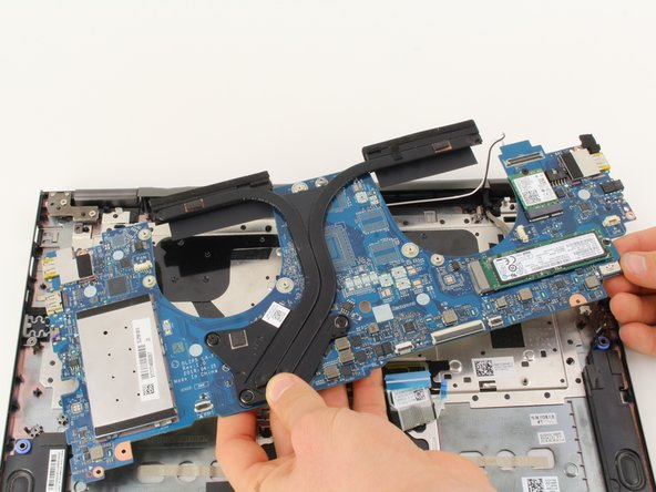 Pull the motherboard up out of the laptop chassis.