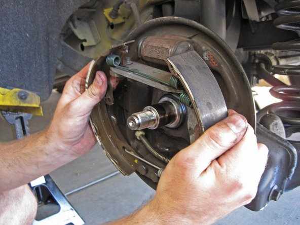 Pull the brake shoe assembly off the backing plate.