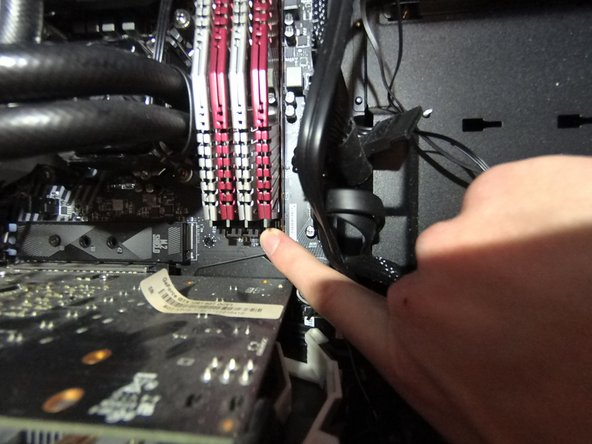 Repeat the same process you did in Step 4 on the clips on the bottom of the RAM sticks.