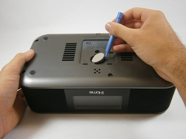 Use a plastic opening tool to take out the backup battery.