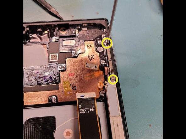 Remove 2 black PH000 Screws on top right lifting flex out.