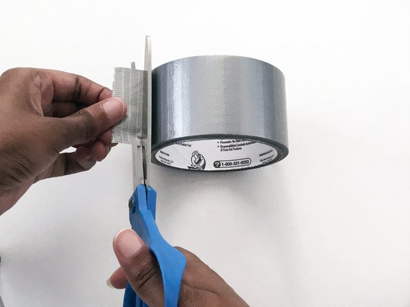 Cut off about a 1-inch piece of heavy duty duct tape.