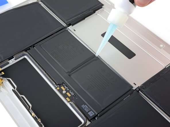 Apply some additional adhesive remover down the middle between the two battery cells.