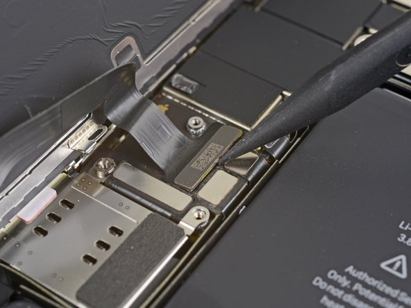 Use a spudger or a fingernail to disconnect the display cable connector.
