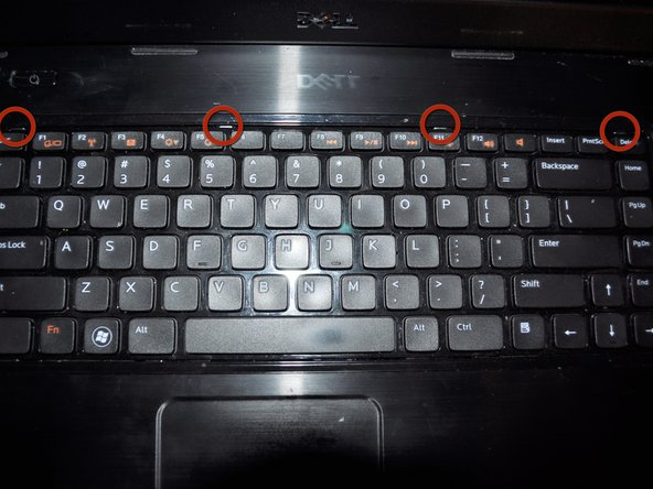 Flip the laptop right side up.  Open the laptop.