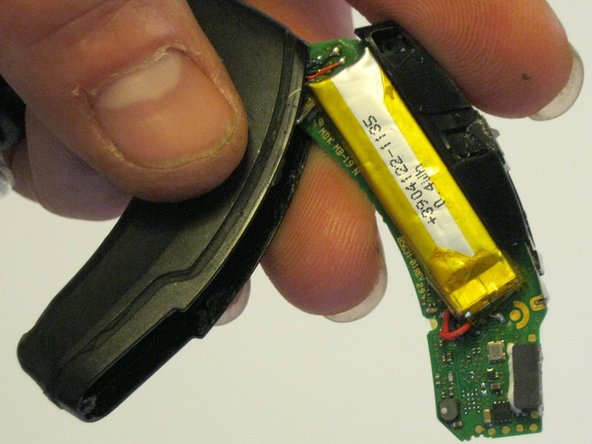Remove the circuit board, revealing the battery unit.