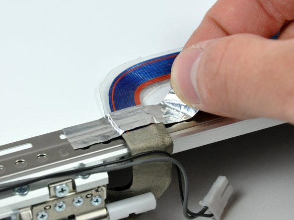 Remove the piece of foil tape securing the display data cable to the LCD frame.