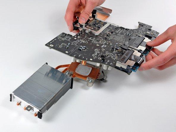 Carefully lift the logic board off the heat sink.