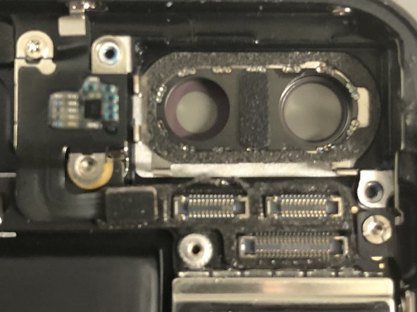 It's difficult to remove this bottom bracket. The inside round edge of this bracket seems to be soldered with camera lens ring; so you need much more effort and it's not surprising to break the bracket altogether.
