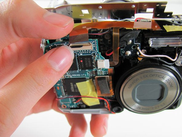 Carefully pull orange LCD connector up and out of the port.