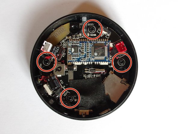 Remove the 4 screws using a screwdriver and take off the PCB from the lower casing.