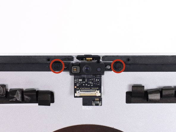 Remove two 4.3 mm T5 screws securing the iSight camera board to the top of the rear case.