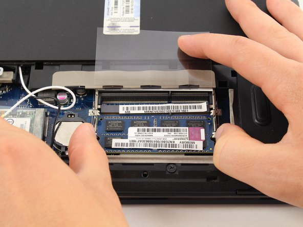 Pull the tabs apart to remove the RAM.