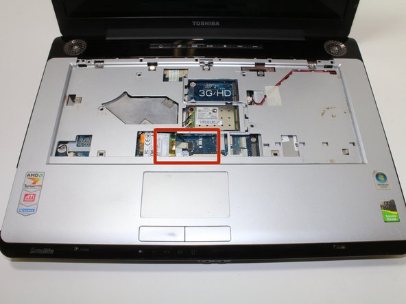 Locate another ribbon cable at the lower center of the keyboard slot.