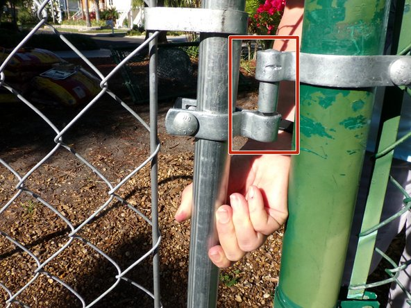Slide the top gate hinge up as you slide the loop over the pin on the top post hinge.