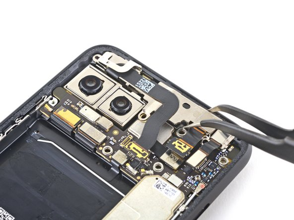 Use a pair of tweezers to remove the front camera and sensor assembly.