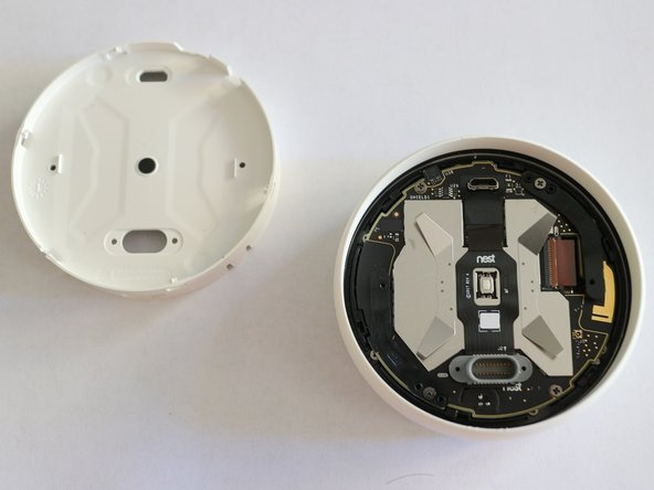 To remove the cover turn it counter clockwise and pull. The cover is held by clips, but it should come off easily after the turn
