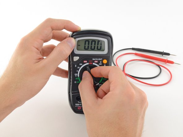 Switch on your multimeter, and set the dial to DC voltage mode (indicated by a V with a straight line, or the symbol ⎓).