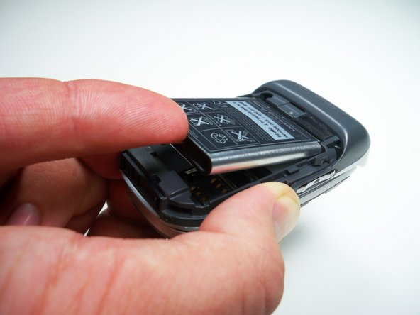 Using a fingernail lift the battery out of the phone.