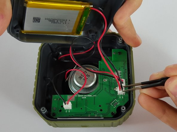 Remove the end of the battery connection from the motherboard by holding the end of the wire and carefully pulling it out of the socket using tweezers.