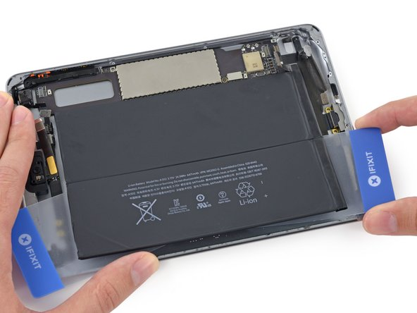 Move the right-hand card up under the other battery cell.
