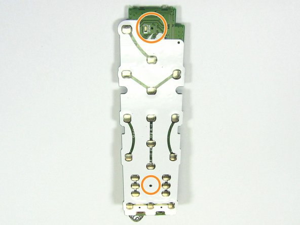A close inspection of the tactile button side of the PCB revealed two small holes.  These small holes turned out to be port openings for dual MEMS Microphones found in the remote.