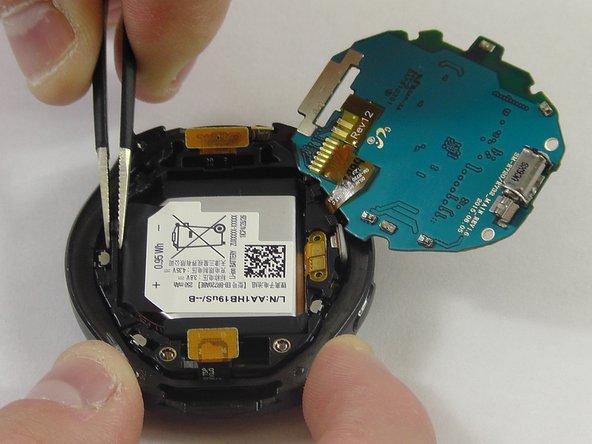 Using tweezers, lift the battery casing.