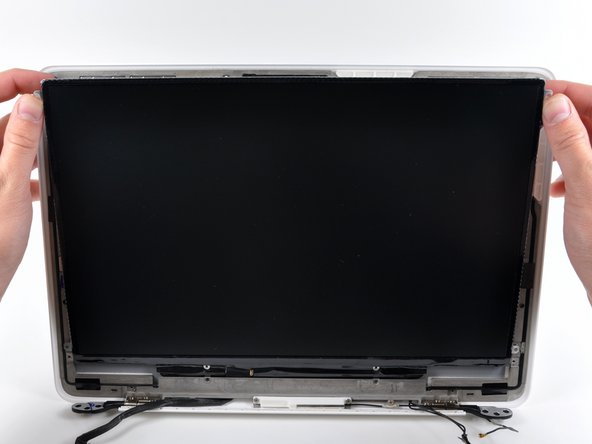 Do not try to remove the LCD yet. The circuitry along its lower edge is wedged in a gap along the lower edge of the display recess in the plastic display assembly.