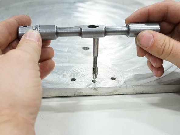 Align the tap attached to the tap handle over the cross threaded or stripped hole.