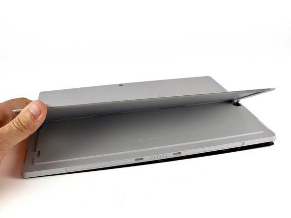 Lift the kickstand to a 90º angle to expose the hinge screws.