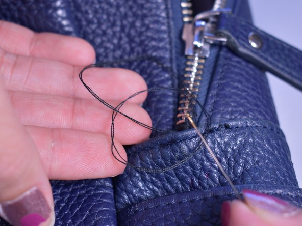 Tie a knot  to finish it off and cut the excess thread with scissors.