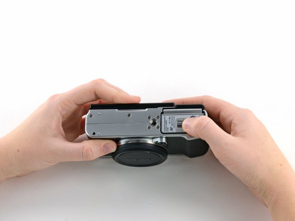 Turn the camera upside down to locate the battery compartment.