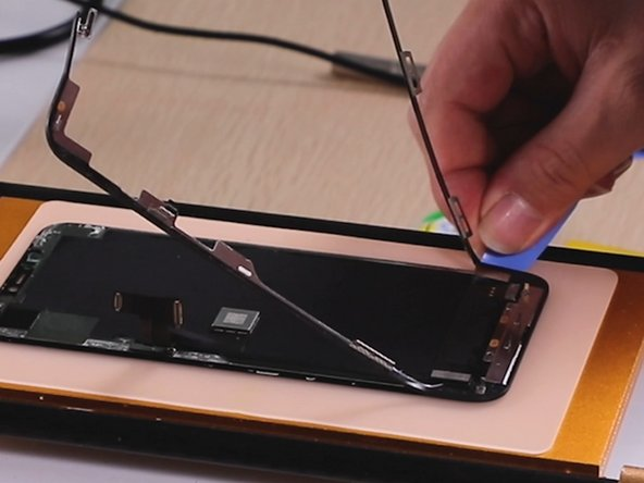 When we remove the bezel, you should remove one side first and stop at the flex cable position. Then remove another side and stop at the flex cable position.