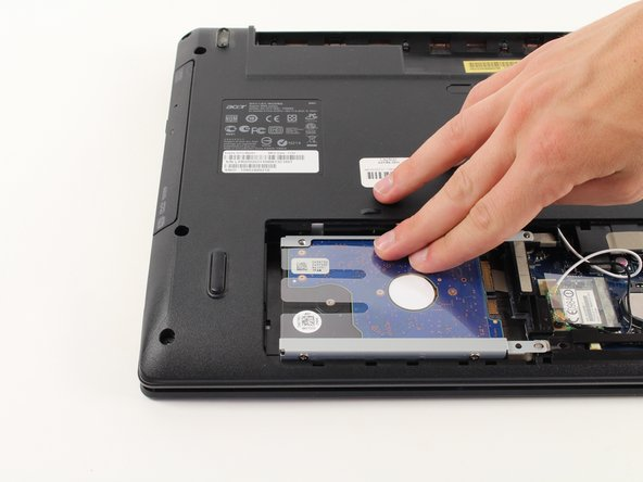 Carefully slide the hard drive in the opposite direction of where the screws are located until it dislocates.
