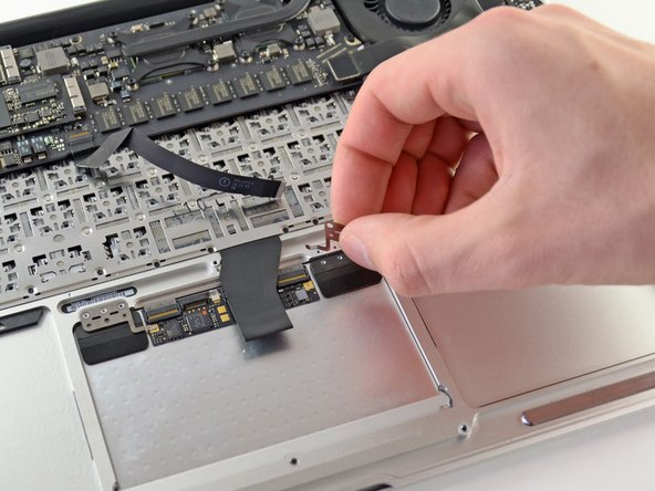 Remove the right and left trackpad brackets  from the upper case.