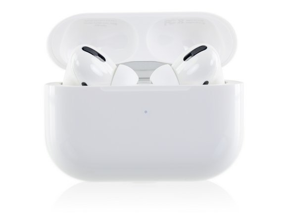The AirPods Pro come in another dental-floss-style case, which opens to reveal the two li'l 'Pods peekin' out.