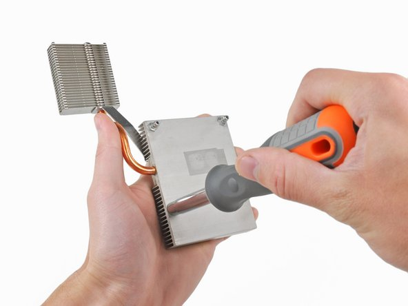 """Use the 1/4"""" socket drive end of the included screwdriver with no bit inserted to remove the four X-clamp posts from both the CPU and GPU heatsinks."""