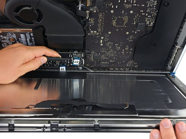 Verify that your iMac is turned off and unplugged from power before you continue.