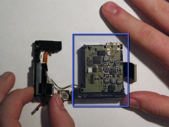 Canon PowerShot SD 600 Rear Accessory Board and Battery Compartment Replacement